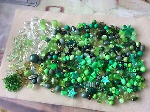 Mixed green acrylic beads. About 205g. Size approx. 4mm up to 20mm. Pack 2.