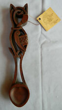 Wooden Welsh love spoon with original artist's tag