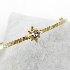 La Vie Parisienne Catherine Popesco Slender Gold Bangle with Stars in Clear
