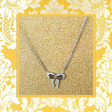 """CC20100 - Eye catching """"silver"""" pendant with shimmering bow stainless steel pen"""