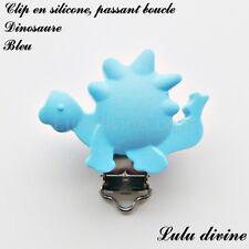 Pince / Clip en silicone, attache tétine, passant boucle, Dinosaure : Bleu
