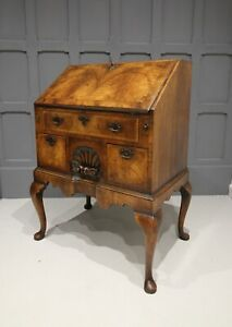A QUEEN ANNE STYLE WALNUT BUREAU