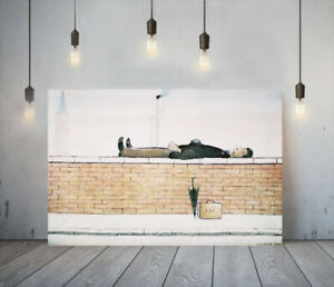LOWRY STYLE MAN ON A WALL -FRAMED CANVAS WALL ART PICTURE PAPER PRINT- BROWN