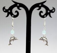 Cute silver alloy dolphin earrings, blue glass cat's eye bead, silver hooks
