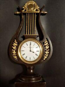 Omega Clock Circa 1915. E.F. Caldwell & Co. Bronze Lyre Form case. Beautiful!