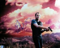 Kiefer Sutherland  Signed Autographed 11X14 Photo Gun with Dark Red Sky GV806554