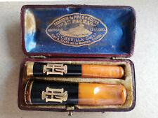 Deux Fume-cigarettes en ambre et or écrin Au Pacha Paris