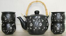 Chinese Porcelain Black Tea Set with Etched Cherry Blossom: Teapot and four Cups