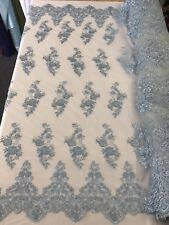 LIGHT BLUE HAND BEADED FLORAL DESIGN EMBROIDERY ON A MESH LACE-SOLD BY YARD.