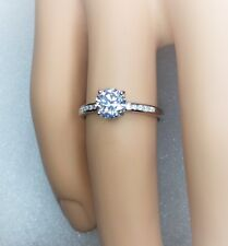 Sterling silver solitaire engagement ring.Hallmarked 925 size S {No.3.030}