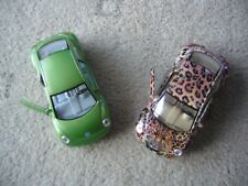 """2 x Kinsmart """" Pull back and go""""  VW New Beetles - Leopard and green"""