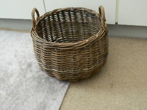 round wicker basket with handles