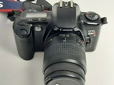 Canon EOS Rebel XS SLR Camera with Canon 35-80mm Zoom Lens, strap and lithium