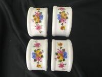 4 Ceramic Napkin Holder Rings Floral on White Background