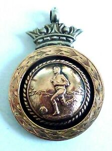 A 1925 BIRMINGHAM HALLMARKED SILVER FOOTBALL WATCH FOB WITH ROSE GOLD FRONT