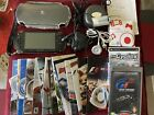 Sony PSP-1003, With Accessories Plus 20 Assorted Games