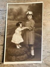 More details for real photo postcard.  girl with large doll.   ref694