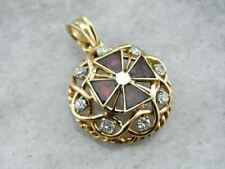 Ruby and Iron, a Vintage Enamel, Diamond and Gold Cross Pendant