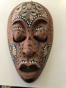 CARVED WOODEN TRIBAL MASK WITH MOTHER OF PEARL INLAY 34 X 20CM HAND-PAINTED