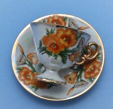 UCAGCO CHINA JAPAN  FOOTED CUP AND SAUCER HAND PAINTED FLORAL
