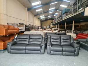 Ex-display Axel black leather manual recliner 3+2 seater sofas
