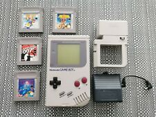Original Nintendo GameBoy DMG con Juegos, paquete de luz y Gamester Power Nuby