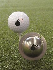 Tin Cup. Golf Ball Marker System. Bombes larguées.
