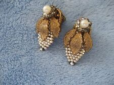 Vintage Miriam Haskell earrings in pearl and rhinestone. Setting is gold colored