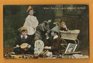CHILDREN- What Santa Claus brought to baby.    Postcard