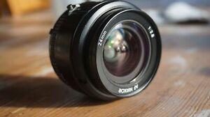 Objectif Nikon AF NIKKOR 24mm f/2.8 avec bouchons