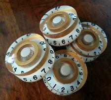 4 Guitar speed volume / tone knobs.. White/Royal Gold. JAT CUSTOM GUITAR PARTS