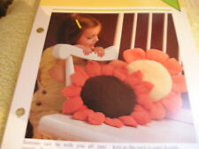 KNITTING PATTERN FOR 2 FLOWER CUSHIONS.