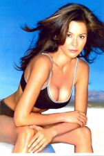 BROOKE BURKE - SITTING IN A CHAIR, LEANING OVER !!!