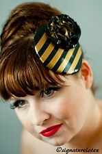 Latex rubber fascinator in black with gold trim and flower. burlesque,
