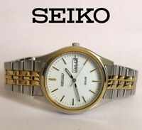 Seiko V158-0AA0 men's solar quartz watch day date indicator stainless steel 1