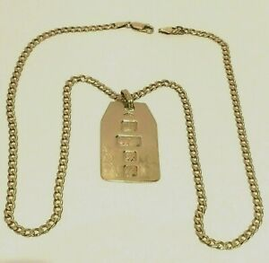 9 CT YELLOW GOLD CURB LINK NECK CHAIN & DOG TAG PENDANT. 21.65.GRAMS.