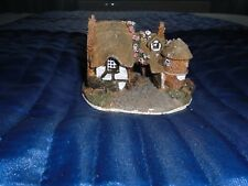 A OLD MODEL OF A COTTAGE IN RESIN