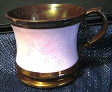 Gorgeous oversized china mug with a pink and bronze coloured glaze