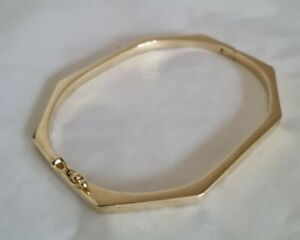 Modern 14 ct Yellow Gold cuff bangle. Of plain Octagonal form.