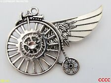 steampunk goth brooch badge silver penny farthing cogs gearwheels feathers wing