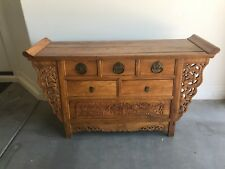 Ming Style Chinese Altar Cabinet with intricate carvings of dragons.