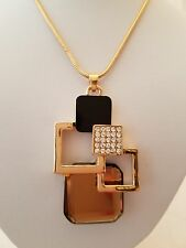Gold 29 Inch Necklace With Abstract Black And Topaz Crystal Pendant
