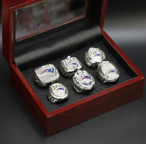 A Set New England Patriots Championship Rings With Wooden Display Case Nice Gift