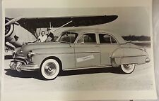 """12 By 18"""" Black & White Picture 1950 Oldsmobile 88 4 door sedan at the airport"""