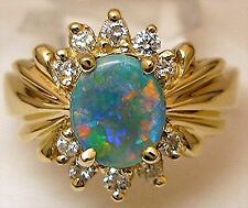 Ladies 14k yellow gold, Australian black opal and diamond ring