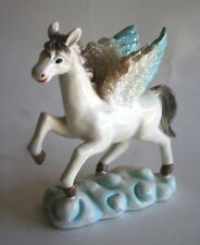 Vintage Figurine of a Majestic Flying Pegasus, Wings Outspread Above the Clouds