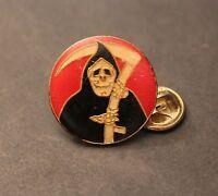 Teschio incappucciato simbolo della Morte con falce in mano - Forma circolare