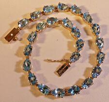 "14k Yellow Gold 12CTW Oval Blue Topaz Tennis Bracelet 5mm x 7-1/4"" long 6.7g"