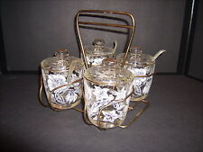 Mid Century 4 Glass Gold Trimmed white floral Condiments w/ lids in Brass Caddy