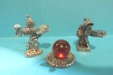 Pair Of Pewter Wizards Casting A Spell Around A Red Crystal Ball